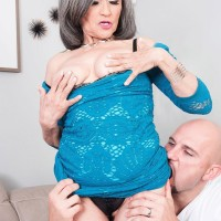 Sixty plus grannie Kokie Del Coco seduces a junior dude in a short dress on the couch