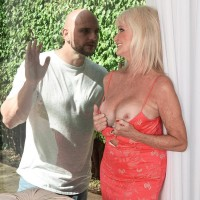 Sixty plus MILF Leah L'Amour tempts a younger guy at the door with her massive titties out