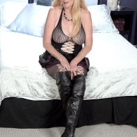 Sandy-haired grannie Charlie whips out her immense melons in over the knee boots and mesh bodystocking