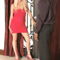 Blonde grandma Marina Johnson salutes her black paramour in red dress and matching high heels