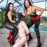 Black-haired Dominatrix Kylie Rogue and mistress abuse masked subby hubby beside pool