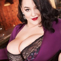 Black-haired MILF Lila Payne revealing humungous hooters in ebony garters and hose