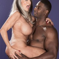 Huge-titted Sixty plus XXX pornstar Sally D'Angelo gets screwed by a junior ebony boy