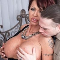 Elegant mature broad Gina Milano tempts a junior dude with her massive juggs