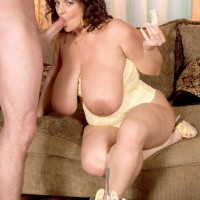 Curvaceous chick Maria Moore vaunting large melons while gobbling food and delivering BLOW JOB