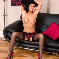 Black-haired elder gal unveiling large knockers and gorgeous backside in hose and high heeled shoes