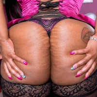 Fat black solo female Cherry Blossoms showcasing huge butt in hose and lingerie