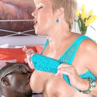Mischievous granny Tracy Licks displays her bare titties to a black guy in a exposing sundress