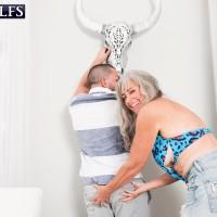 Beautiful Sixty plus MILF Silva Foxx seduces a junior man by demonstrating her boobies in a denim microskirt