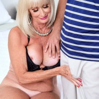 Cool grandma Leah L'Amour deep-throats and plumbs a big prick while her spouse sleeps