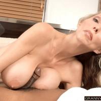 Sexy aged gal Ophelia Vixxxen deep-throats and nails a large ebony prick