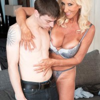 Provocative over Sixty MILF Madison Milstar entices a junior dude in her melon-holder and underwear