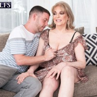 Experienced gal Crystal King has her gigantic tits played with by a junior dude