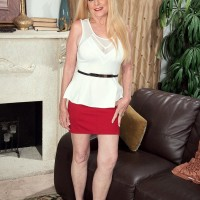 Old light-haired gal Charlie has her gigantic knockers revealed by junior man in a red microskirt