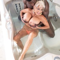 Sex granny Sally D'Angelo and her giant boobs take on a BIG EBONY DICK outdoors in a Jacuzzi
