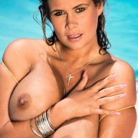 Solo model Trinity Loren displays off her giant knockers while taking a dip in the pool