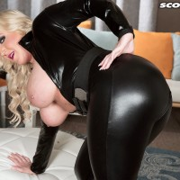 Thick platinum-blonde model Holly Prick letting hefty all-natural boobies loose from leather outfit