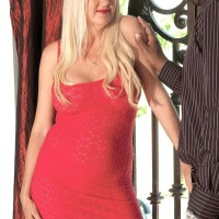 Yellow-haired granny Marina Johnson has her first multiracial sex experience in a crimson sundress