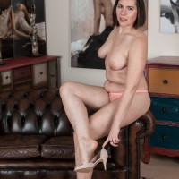 Gangly dark-haired first-timer unleashing flappy tits from brassiere before opening up fur covered snatch