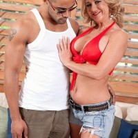 Elder light-haired lady Cali Houston releasing gigantic boobs while seducing younger boy