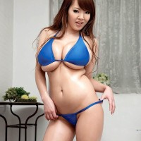 Asian MILF Hitomi looses her gigantic funbags from her bathing suit top in high-heels