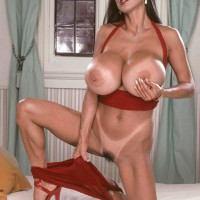 Asian MILF X-rated starlet Minka pulling out large titties from crimson sundress in stilettos