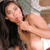 Oriental solo model Minka extracts her hefty titties from her bra army fatigues