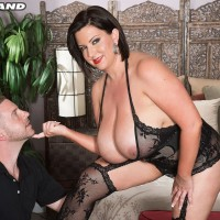 Gigantic boobed brunette Paige Turner giving hand-job after nipple sucking in nylons