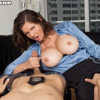 Large breasted dark haired policewoman June Summers delivering hand job to giant dick