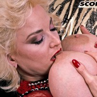 Monster-sized breasted sandy-haired Chessie Moore fellates on her hard nipples before sliding undies aside