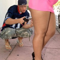 Ebony female Sugary Louis flaunting giant bootie outdoors wearing micro skirt and heels