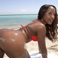 Ebony solo female Sapphira flashing giant caboose on beach garmented red swimsuit