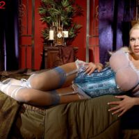 Golden-haired babe Kylee Nash loosing huge breasts in spectacular lingerie and pantyhose