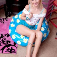 Blond babe Sammy Daniels sliding cut-offs over tush and legs to unveil undies