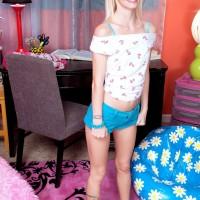 Blond babe Sammy Daniels sliding cut-offs over tush and legs to unveil undies