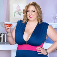 Blond BIG HOT LADY Amiee Roberts exposes her monster-sized hooters from her dress over a glass of champagne