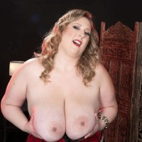 Blond BIG SEXY LADY Amiee Roberts plays with her monster-sized breasts after pulling them out