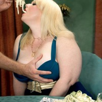 Golden-haired BBW pornographic star Dawn Davenport tugging dick while licking food and masturbating