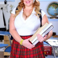 Sandy-haired BBW solo female Mya Blair strutting in college girl uniform, glasses and ponytails