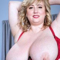 Blond BIG HOT LADY solo model Laddie Lynn letting gigantic flappy boobies free from lingerie