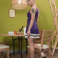 Sandy-haired European first timer Nikitina unleashing unshaven slit from panties in stilettos