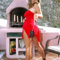 Blond European XXX film starlet Ines Cudna pulling out gigantic boobs from dress outdoors
