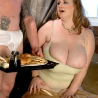 Fair-haired feeder Sapphire exposing humungous funbags before delivering hand-job while munching