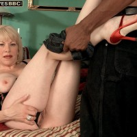 Blond grannie Jennifer Janes has her juggs caressed while being unclothed by a black stud