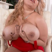 Light-haired Latina MILF Nancy Navarro uncovering large natural knockers in high heeled shoes