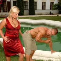 Ash-blonde MILF Lucy Enjoy whipping out massive boobs for jugg sucking from ebony boy by pool