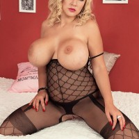 Platinum-blonde model Dolly Fox sets her increased hooters free of wondrous body-stocking in stilettos