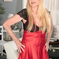 Ash-blonde Nan Charlie entices a junior stud in lingerie and ebony nylons