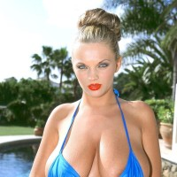 Ash-blonde solo chick Ines Cudna sets her massive natural titties free from bathing suit top by the pool