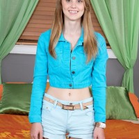 Light-haired teenager Lily Rader exposing smallish tits and undies after denim shorts removal